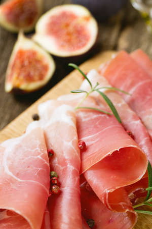 sliced prosciutto on a wooden board Stock Photo - 22831555