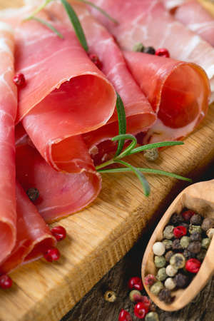 sliced prosciutto on a wooden board Stock Photo - 22831556