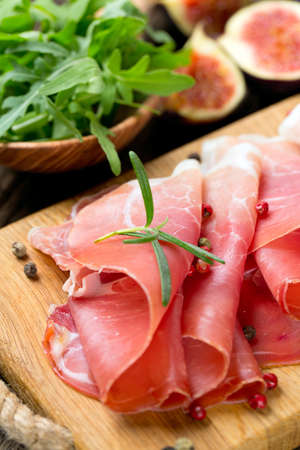 sliced prosciutto on a wooden board Stock Photo - 22831557