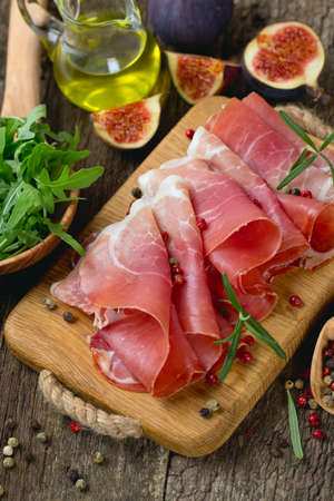 sliced prosciutto on a wooden board Stock Photo - 22831558