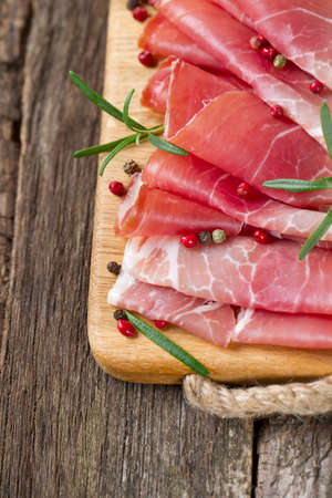sliced prosciutto on a wooden table Stock Photo - 22956806
