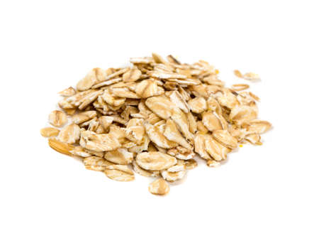 oatmeal cookie: oat flakes isolated on white