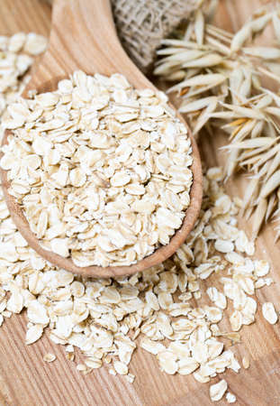 oat flakes in a spoon on wooden surface Stock Photo - 22956873