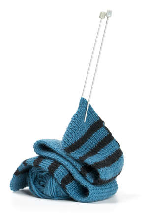 striped scarf on knitting needles over white photo