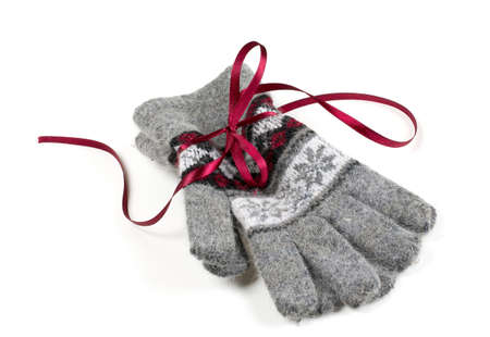 grey gloves with a ribbon isolated on white photo