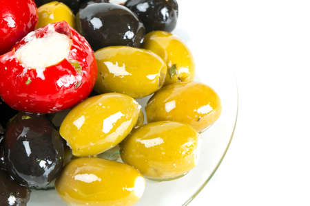 assortment of marinated olives isolated on white photo
