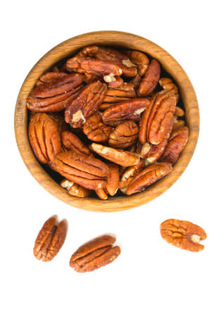 anti oxidants: pecan nuts in a wooden bowl