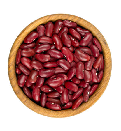 dried red beans in a wooden bowl isolated on white background photo