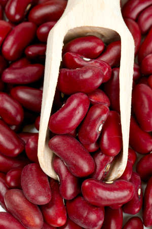 rajma: dried red beans in a wooden scoop isolated on white background Stock Photo