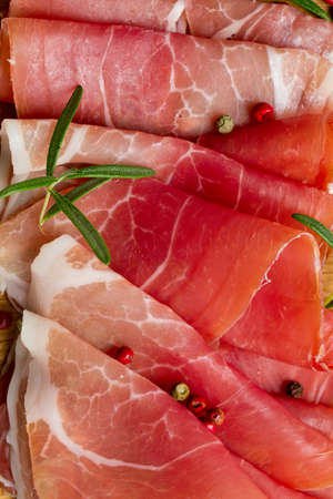 sliced prosciutto on a wooden table Stock Photo - 23639147