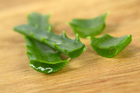 acemannan: aloe vera on wooden surface Stock Photo