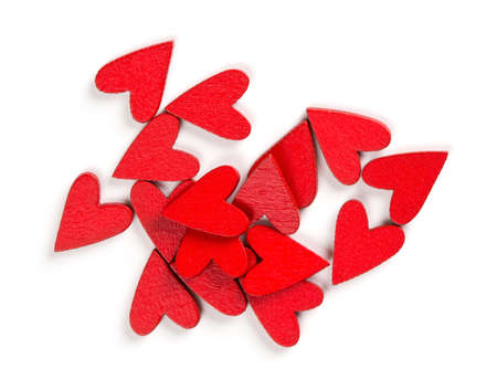 red wooden hearts isolated on white photo