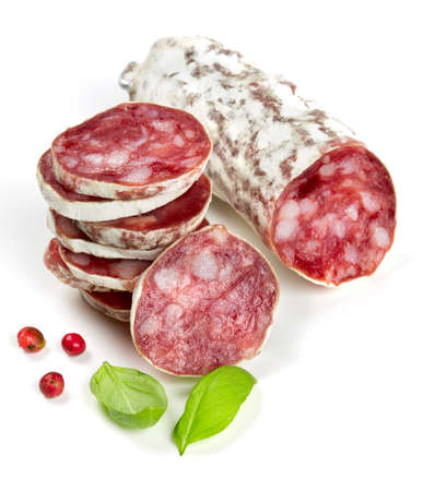 stacked sliced salami isolated on white photo