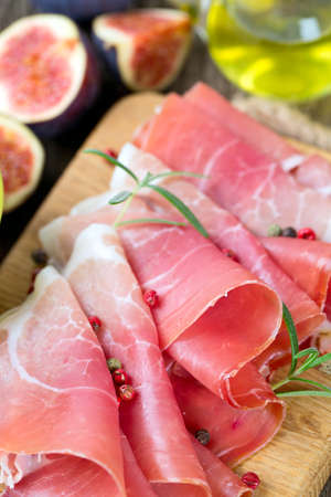 sliced prosciutto on a wooden board Stock Photo - 24027400
