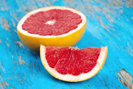 fresh ripe grapefruit on wooden surface photo