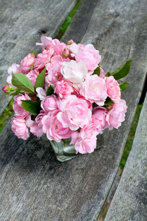 bouquet of roses on wooden surface photo