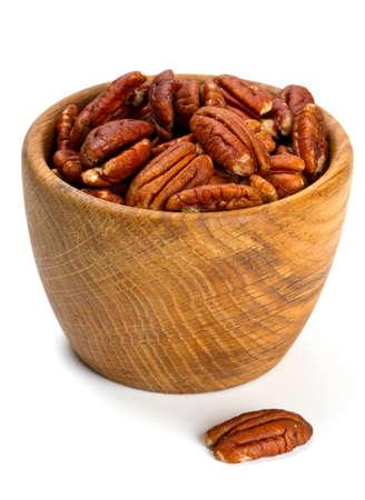 un healthy: pecan nuts in a wooden bowl