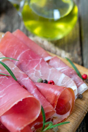 sliced prosciutto on a wooden board Stock Photo - 24877449