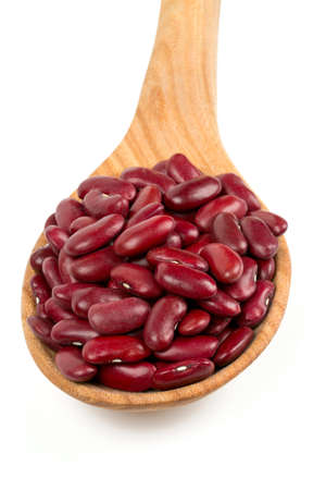 rajma: dried red beans in a spoon isolated on white background