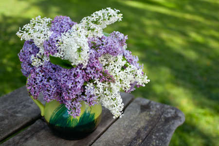lilac on wooden table photo