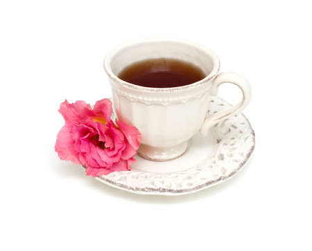 cup of tea and flower isolated on white background photo