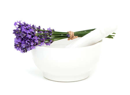 Mortar and a bouquet of lavender isolated on white  photo
