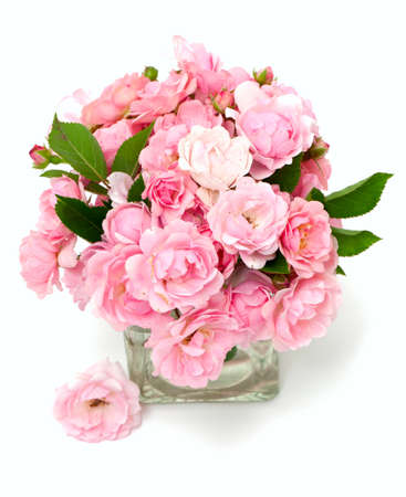 pink roses in a glass vase Stock Photo