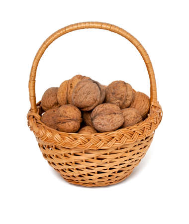 walnuts in basket isolated on white photo