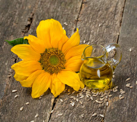 sunflower seed oil on wooden surface photo