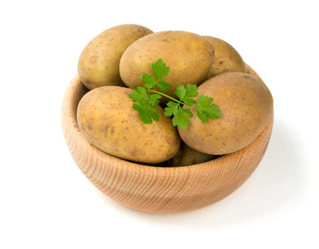 ripe potatoes isolated on white photo