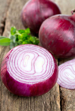 red onion on rustuc background photo