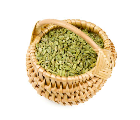 fennel seeds in a basket isolated on white background photo