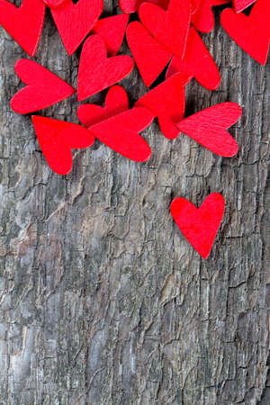 red hearts on rustic wooden surface photo