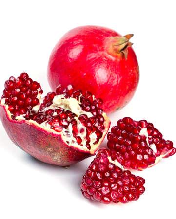 fresh pomegranate isolated on white background photo