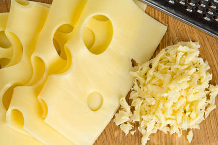 cheese on cutting board photo
