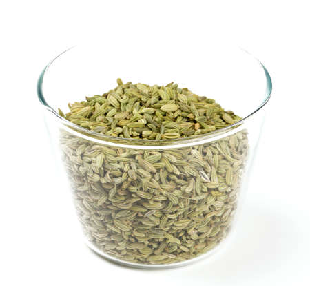 fennel seeds in a glass bowl isolated on white background photo