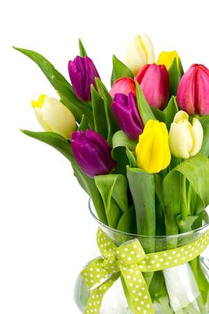 vase with tulips isolated on white photo