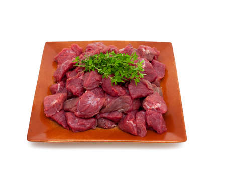 fresh beef meat with thyme isolated on white background photo