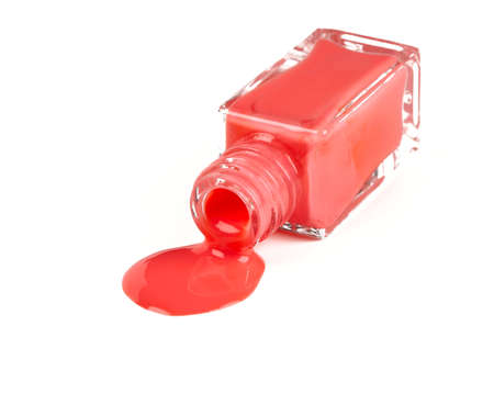 pink polish bottle spilled over white background photo