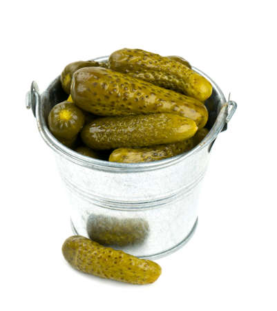 pickled cucumbers in a metal bucket isolated on white photo