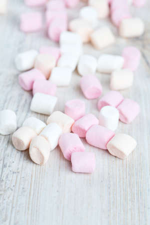 marshmallows on wooden table photo