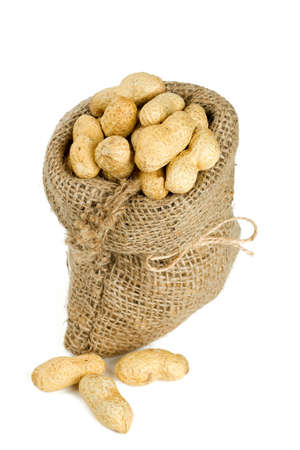 peanuts in a miniature burlap bag isolated on white photo