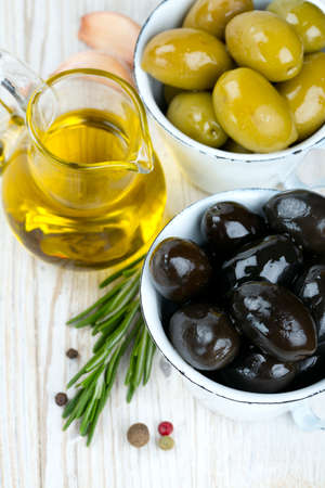 green and black olives on wooden surface photo