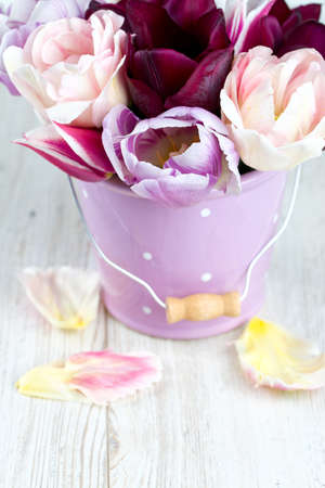 bouquet of tulips on wooden surface photo