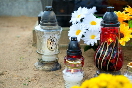 candles and flowers at cemetery photo