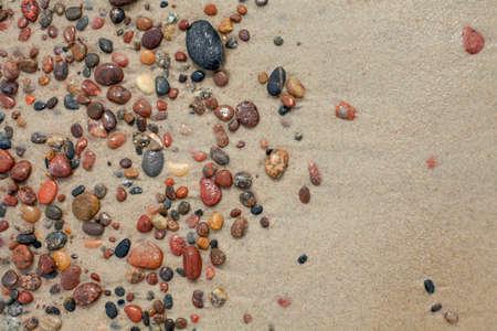 wet stones on beach photo