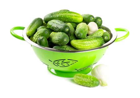 english cucumber: fresh cucumbers in a green colander