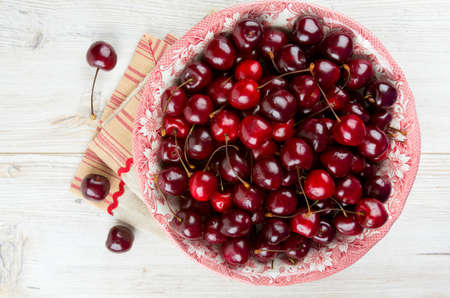 cherries on wooden table photo
