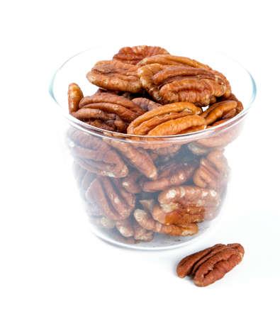 un healthy: pecan nuts in a glass bowl