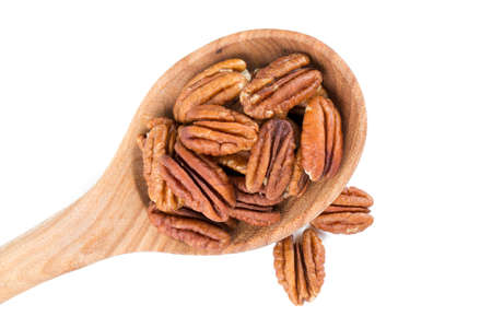 anti oxidants: pecan nuts in a wooden spoon Stock Photo